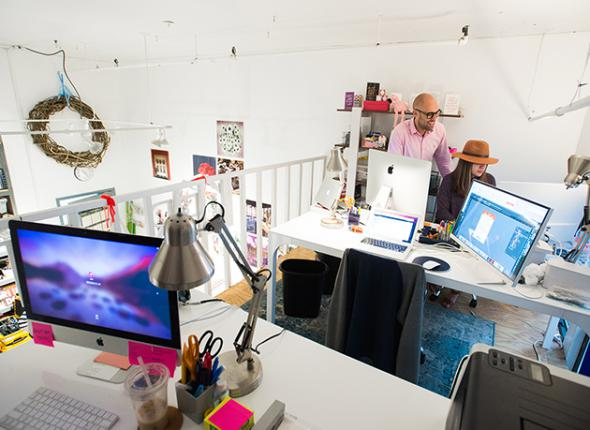 A creative workspace with two people collaborating.
