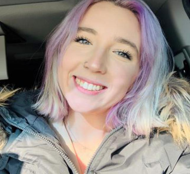 Image of girl with rainbow hair smiling