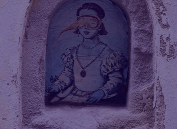 A drawing of a woman on an old wall.